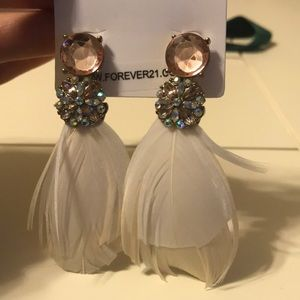 Gorgeous statement earrings with feathers